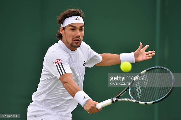 Italy's Fabio Fognini returns against Austria's Jurgen Melzer in their men's first round match on day one of the 2013 Wimbledon Championships tennis...