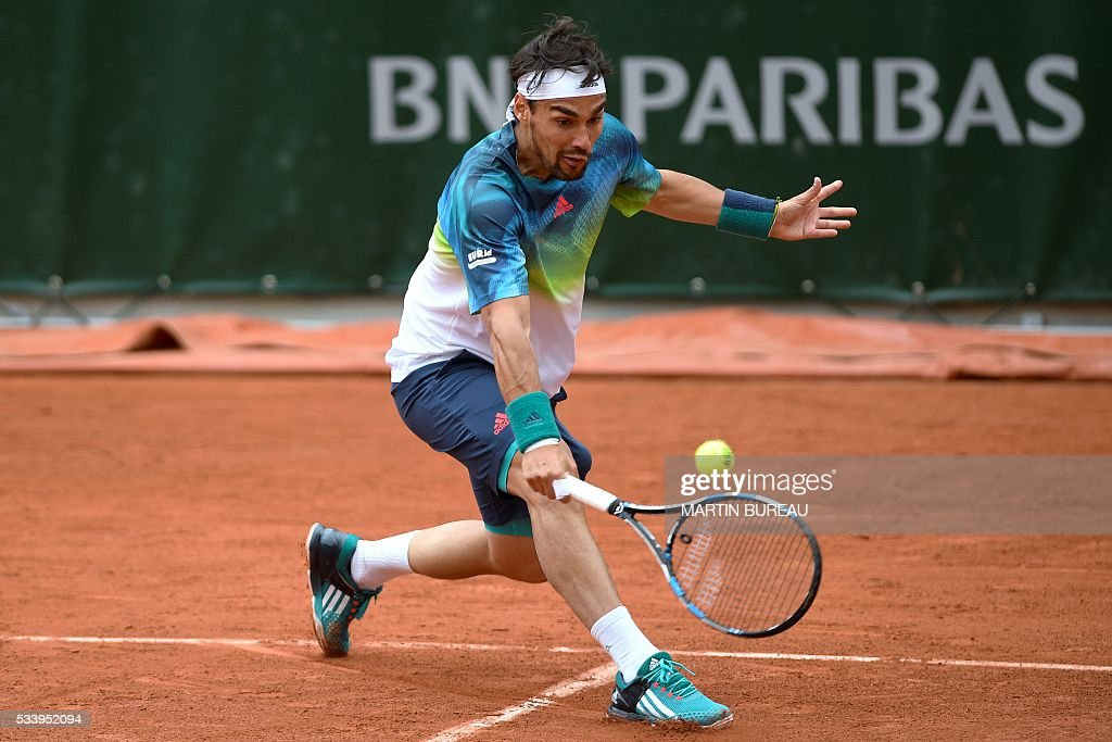 Italy's Fabio Fognini returns the ball to Spain's Marcel Granollers during their men's first round match at the Roland Garros 2016 French Tennis Open in Paris on May 24, 2016. / AFP / MARTIN