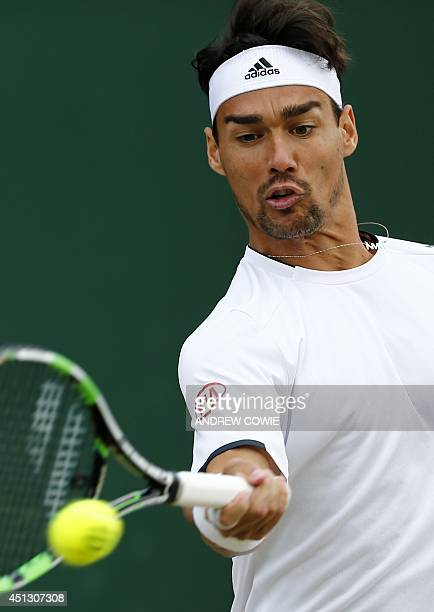 Italy's Fabio Fognini returns to South Africa's Kevin Anderson during their men's singles third round match on day five of the 2014 Wimbledon...