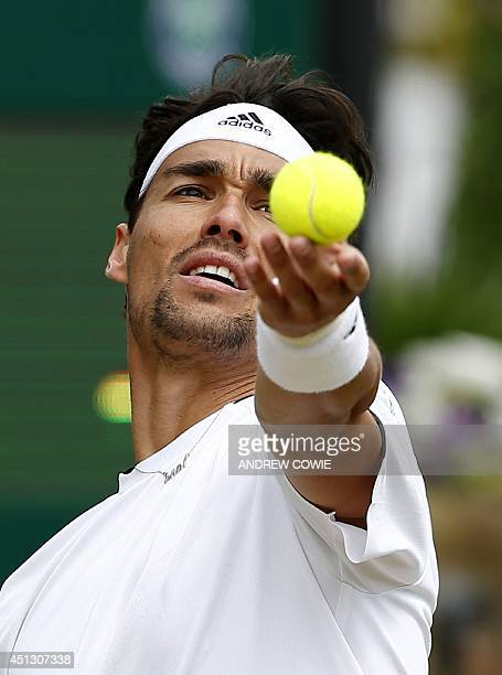 Italy's Fabio Fognini serves to South Africa's Kevin Anderson during their men's singles third round match on day five of the 2014 Wimbledon...