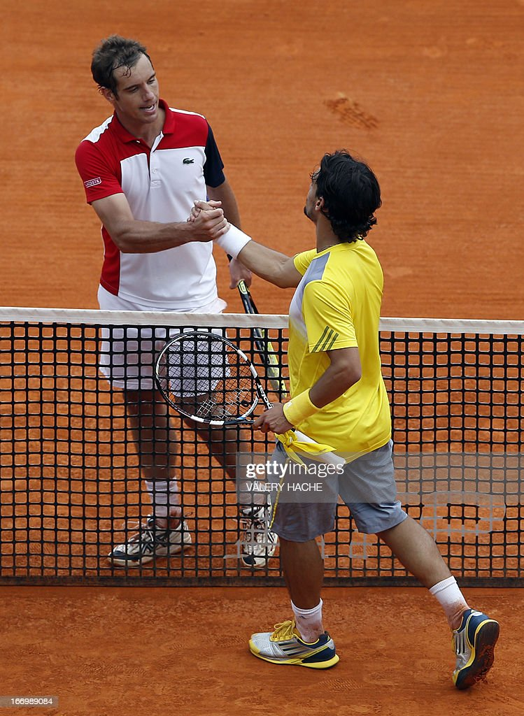 Italy's Fabio Fognini (R) shakes hands with France's Richard Gasquet after defeating him in a Monte-Carlo ATP Masters Series Tournament quarter final tennis match on April 19, 2013 in Monaco.