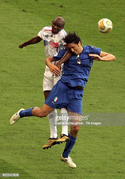 Italy's Fabio Grosso and France's Patrick Vieira battle for the ball