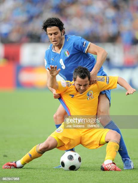 Italy's Fabio Grosso and Romania's Florentin Petre battle for the ball