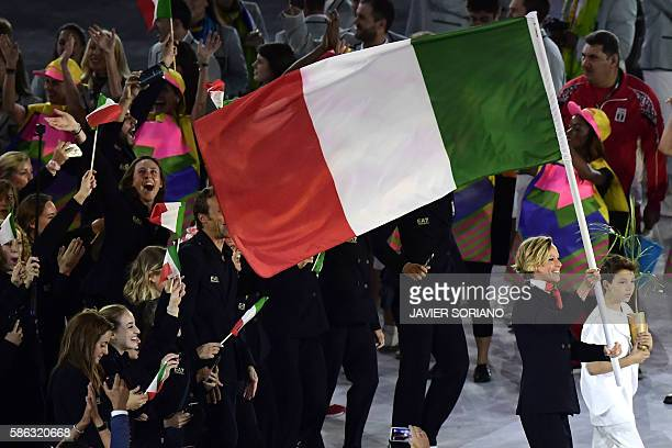 Italy's Federica Pellegrini carries their country's flag as they lead teammates into the stadium during the opening ceremony of the Rio 2016 Olympic...