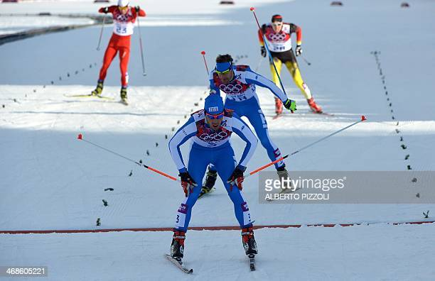 Italy's Federico Pellegrino crosses the finish line in front of Italy's David Hofer during the Men's CrossCountry Skiing Individual Sprint Free...