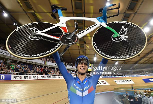 Italy's Filippo Ganna celebrates taking gold in the Men's Individual pursuit final during the 2016 Track Cycling World Championships at the Lee...