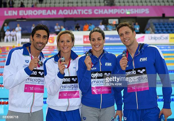 Italy's Filippo Magnini Federica Pellegrini Erika Ferraioli and Luca Dotto pose for pictures with their silver medals after taking part in the Mixed...