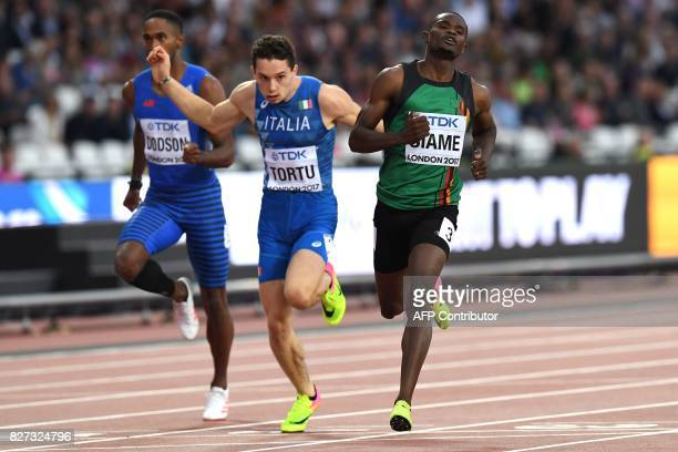 Italy's Filippo Tortu and Zambia's Sydney Siame compete in the heats of the men's 200m athletics event at the 2017 IAAF World Championships at the...
