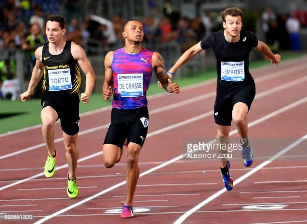 Italy's Filippo Tortu Canada's Andre de Grasse and France's Christophe Lemaitre compete in the men's 200m event at the Rome meeting of the IAAF...