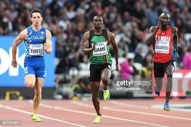 Italy's Filippo Tortu Zambia's Sydney Siame and Gambia's Adama Jammeh compete in the heats of the men's 200m athletics event at the 2017 IAAF World...