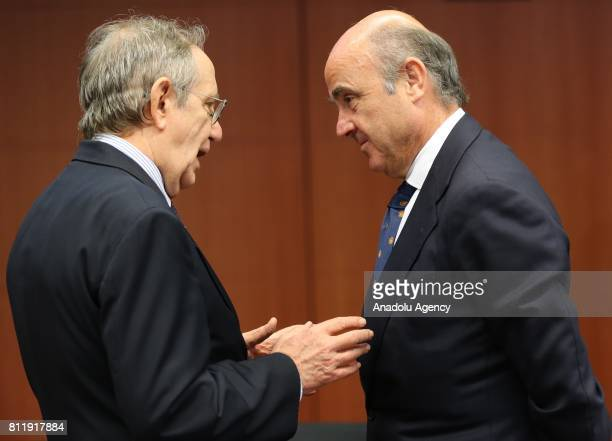 Italy's Finance Minister Pier Carlo Padoan and Spain's Finance Minister Luis de Guindos attend the Eurogroup meeting of European finance ministers in...