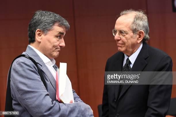 Italy's Finance Minister Pier Carlo Padoan speaks to Greece's Finance Minister Euclid Tsakalotos during a Eurogroup finance ministers meeting on May...
