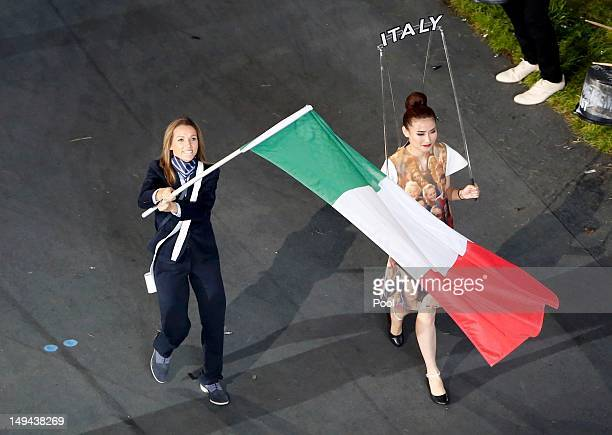 Italy's flagbearer Valentina Vezzali leads the contingent in the athletes parade during the opening ceremony of the London 2012 Olympic Games at the...