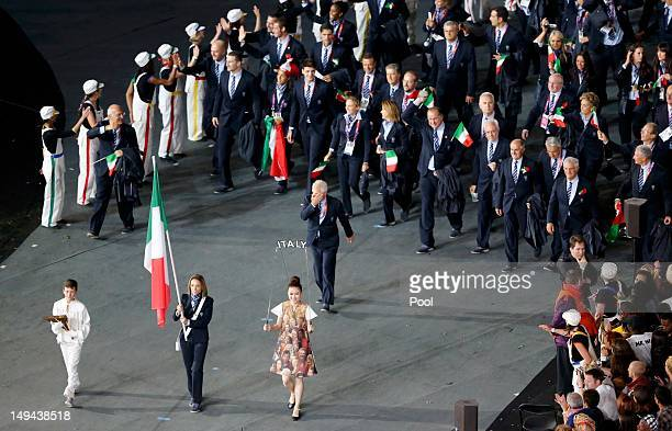 Italy's flagbearer Valentina Vezzali leads the contingent in the athletes paradeduring the opening ceremony of the London 2012 Olympic Games at the...