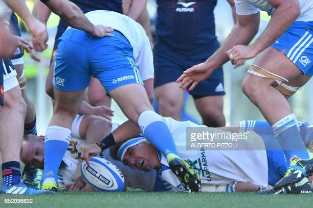 Italy's flanker Dries van Schalkwyk fights for the ball during the International Six Nations rugby union match Italy vs France on March 11 2017 at...