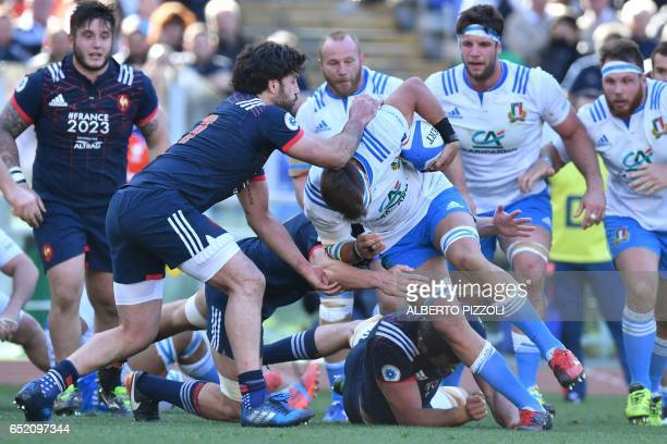 Italy's flanker Dries van Schalkwyk fights for the ball with France's flanker Kevin Gourdon during the International Six Nations rugby union match...