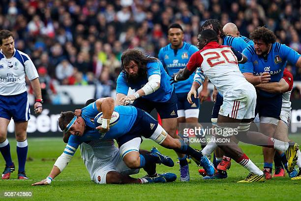 Italy's flanker Dries van Schalkwyk is tackled during the Six Nations international rugby union match between France and Italy at the Stade de France...