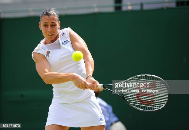 Italy's Flavia Pennetta in action against Belgium's Kirsten Flipkens during day seven of the Wimbledon Championships at The All England Lawn Tennis...
