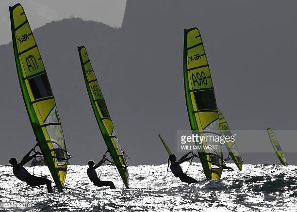 TOPSHOT Italy's Flavia Tartaglini Denmark's Laerke BuhlHansen and Brazil's Patricia Freitas compete in the RSX Women sailing class on Guanabara Bay...