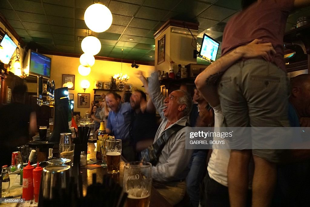 Italy's football fans celebrate the second goal of their team on June 27, 2016 in a bar in Rome, during the Euro 2016 football match between Spain and Italy held at the Stade de France stadium in Paris, France. Italy won 2-0.