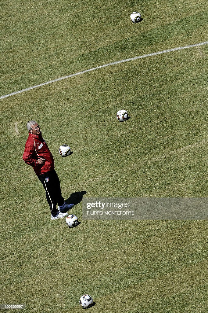Italy's football team coach Marcello Lippi watches his players during a training camp in Sestriere on May 24, 2010 ahead of the 2010 FIFA World Cup in South Africa. AFP PHOTO / Filippo MONTEFORTE