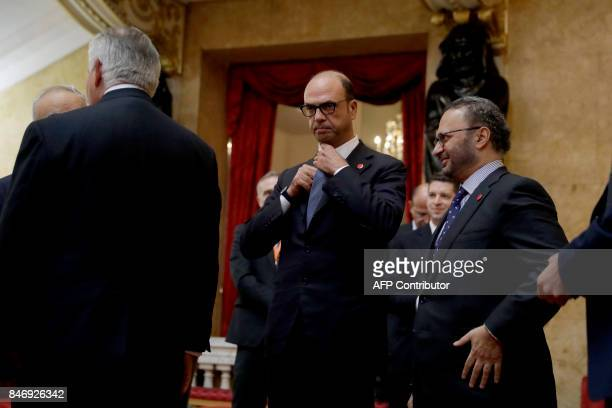 Italy's Foreign Minister Angelino Alfano prepares to pose for a group photograph with Britain's Foreign Secretary Boris Johnson at Lancaster House in...