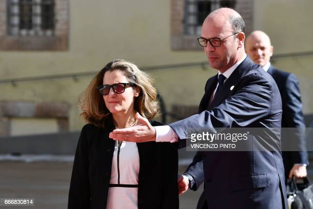 Italy's Foreign Minister Angelino Alfano welcomes Canadian Foreign Minister Chrystia Freeland as she arrives for a meeting of Foreign Affairs...