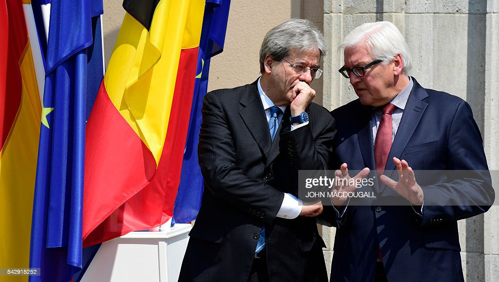 Italy's Foreign minister Paolo Gentiloni (L) and Germany's Foreign minister Frank-Walter Steinmeier talk during a press conference after talks at the Villa Borsig in Berlin on June 25, 2016. The EU's founding states said they want Britain to begin leaving the union 'as soon as possible', as France urged a new British prime minister to take office quickly. / AFP / John MACDOUGALL
