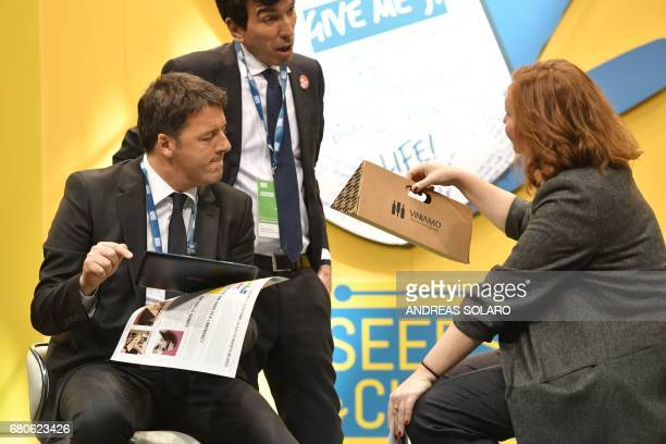 Italy's former Prime Minister and general secretary of the Democratic Party Matteo Renzi and Italy's Agriculture Minister Maurizio Martina attend the...