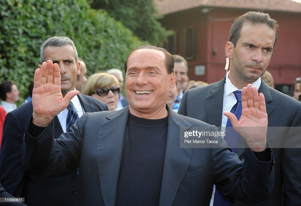 Italy's former Prime Minister <a gi-track='captionPersonalityLinkClicked' href=/galleries/search?phrase=Silvio+Berlusconi&family=editorial&specificpeople=201842 ng-click='$event.stopPropagation()'>Silvio Berlusconi</a> and leader of People of freedom political party (PDL) hails his supporters in front of his house Villa San Martino on July 1, 2013 in Milan, Italy.Supporters of PDL party gather at Berlusconi's house, to support him after the guilty verdict.