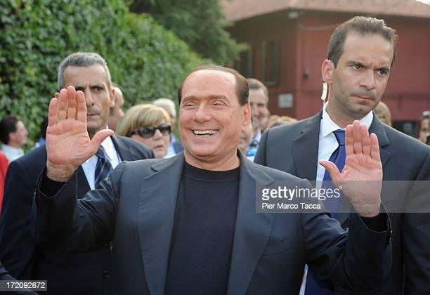 Italy's former Prime Minister Silvio Berlusconi and leader of People of freedom political party hails his supporters in front of his house Villa San...