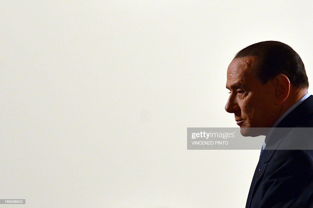 Italy's former Prime Minister Silvio Berlusconi arrives to a campaign rally to present the list of the PDL candidates for the upcoming elections, in Rome on January 25, 2013. AFP PHOTO / VINCENZO PINTO