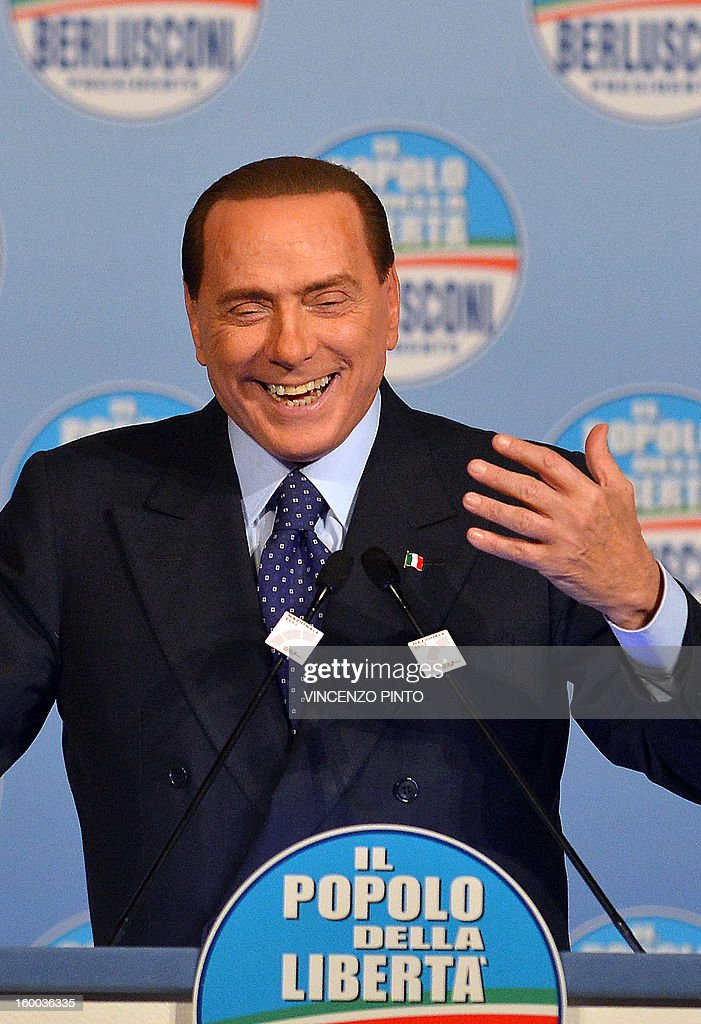 Italy's former Prime Minister Silvio Berlusconi delivers a speech during a campaign rally to present the list of the PDL candidates for the upcoming elections, in Rome on January 25, 2013. AFP PHOTO / VINCENZO PINTO