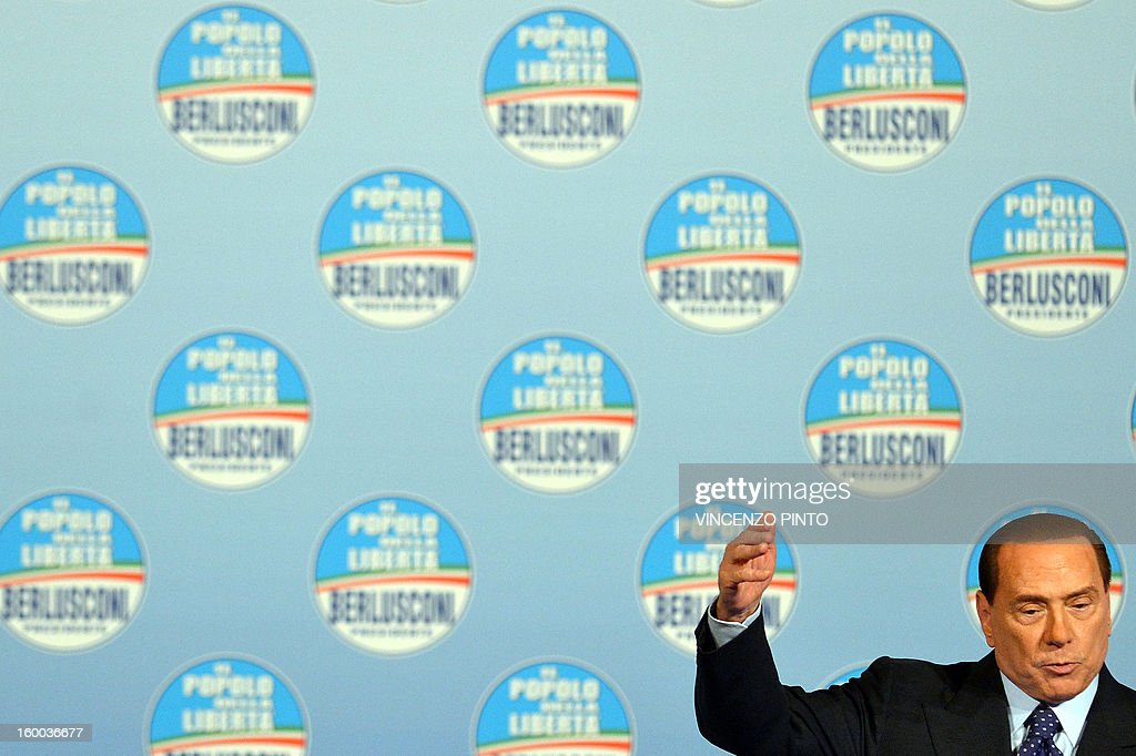 Italy's former Prime Minister Silvio Berlusconi delivers a speech during a campaign rally to present the list of the PDL candidates for the upcoming elections, in Rome on January 25, 2013.