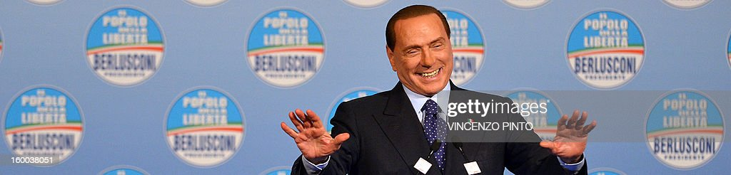 Italy's former Prime Minister Silvio Berlusconi delivers a speech during a campaign rally to present the list of the PDL right-wing party candidates for the upcoming general elections, in Rome on January 25, 2013.