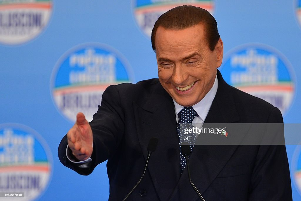 Italy's former prime minister Silvio Berlusconi delivers a speech during a rally of his party the Popoplo della liberta (PDL) on February 3, 2013 in Milan.