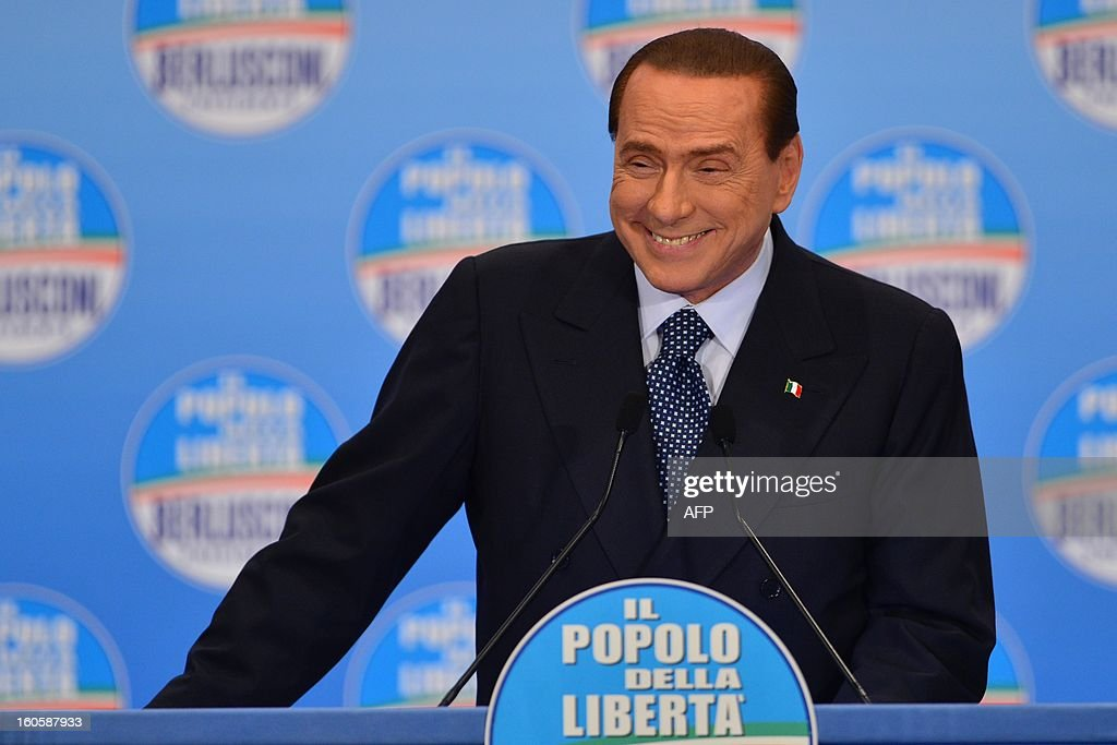 Italy's former prime minister Silvio Berlusconi delivers a speech during a rally of his party the Popoplo della liberta (PDL) on February 3, 2013 in Milan. AFP PHOTO / GIUSEPPE CACACE