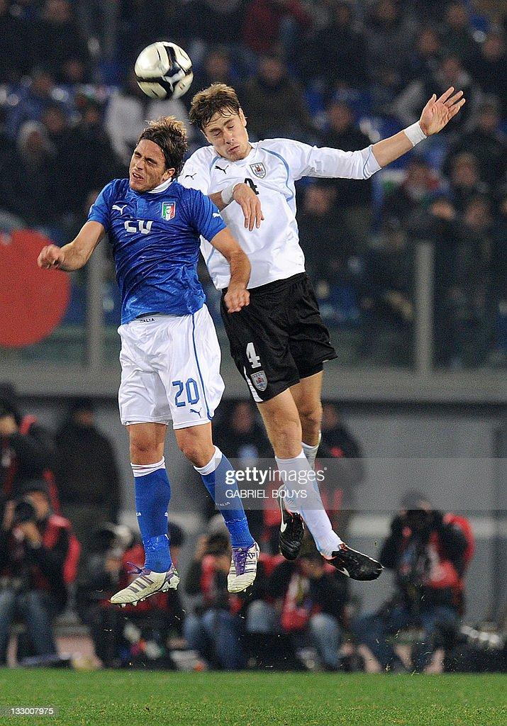 Italy's forward Alessandro Matri and Uruguay's defender Andres Scotti fight for the ball during the friendly football match between Italy and Uruguay...