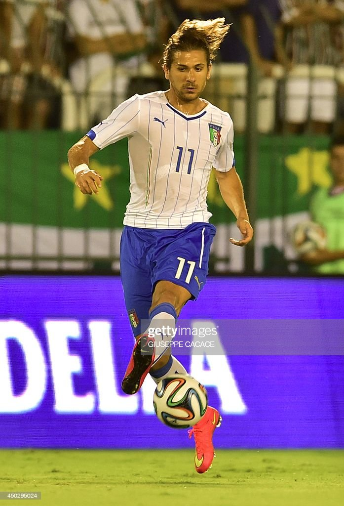 Italy's forward Alessio Cerci controls the ball during a friendly football match between Fluminense FC and Italy at The Raulino de Oliveira Stadium in Volta Redonda on June 8, 2014, a few days before the start of the 2014 FIFA World Cup.