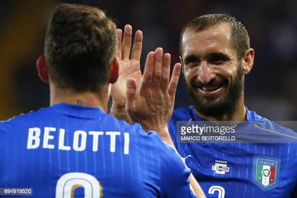 Italy's forward Andrea Belotti celebrates after scoring with his teammate Italy's defender Giorgio Chiellini during the FIFA World Cup 2018...