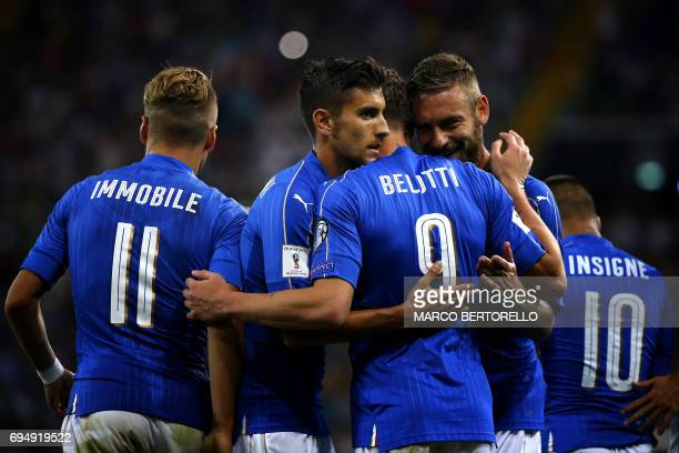 Italy's forward Andrea Belotti celebrates after scoring with his teammates during the FIFA World Cup 2018 qualification football match between Italy...