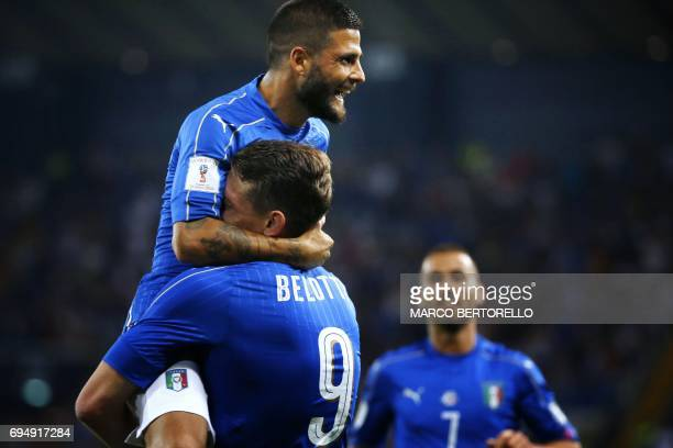 Italy's forward Andrea Belotti celebrates with Italy's forward Lorenzo Insigne after scoring a goal during the FIFA World Cup 2018 qualification...