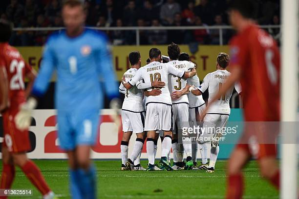 Italy's forward Andrea Belotti celebrates with teammates after scoring a goal during the FIFA World Cup 2018 qualifying football match between...