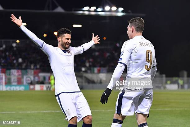 Italy's forward Andrea Belotti is congratulated by temmate midfielder Antonio Candreva after scoring the team's first goal during the FIFA World Cup...