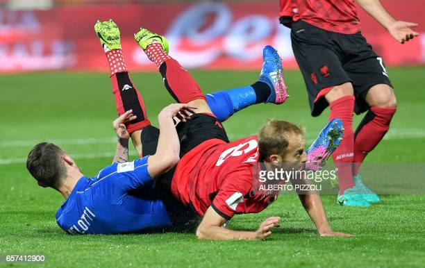 Italy's forward Andrea Belotti is takled by Albania's defender Naser Aliji and obtains a penalty kick during the World Cup 2018 group G qualification...