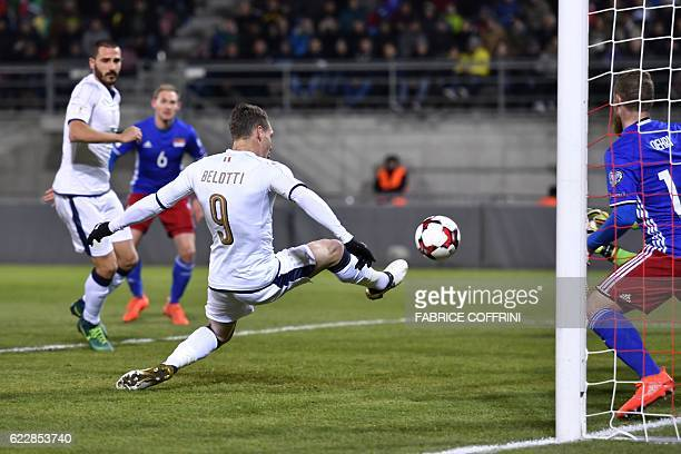 Italy's forward Andrea Belotti scores the team's first goal during the FIFA World Cup 2018 European group G Qualifiers football match beetween...