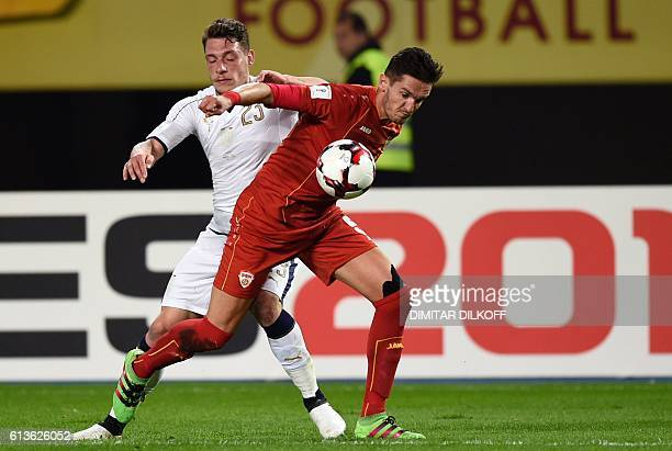 Italy's forward Andrea Belotti vies with Macedonia's defender Daniel Mojsov during the FIFA World Cup 2018 qualifying football match between...