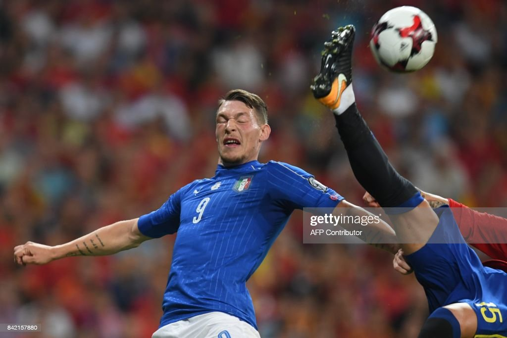 Italy's forward Andrea Belotti (L) vies with Spain's defender Sergio Ramos during the World Cup 2018 qualifier football match between Spain and Italy at the Santiago Bernabeu stadium in Madrid on September 2, 2017. /