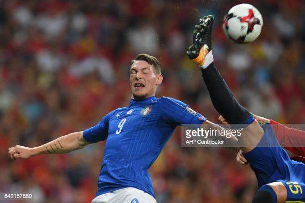 Italy's forward Andrea Belotti vies with Spain's defender Sergio Ramos during the World Cup 2018 qualifier football match between Spain and Italy at...