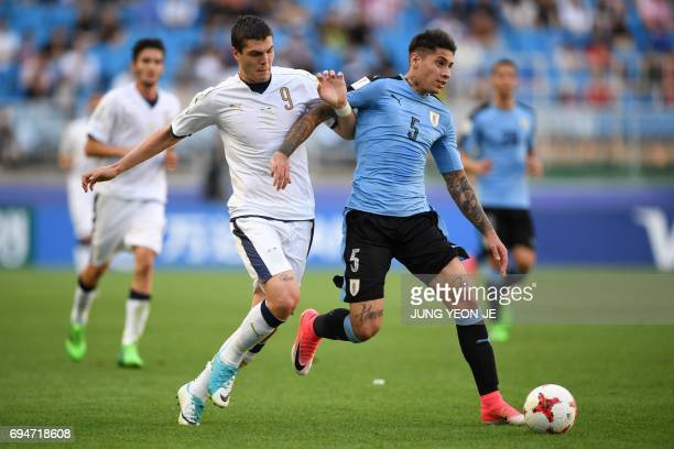 Italy's forward Andrea Favilli and Uruguay's defender Mathias Olivera compete for the ball during the U20 World Cup third place playoff football...